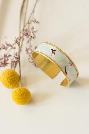 bracelet manchette rebord doré bleu ciel grues clémica